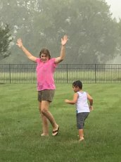 Adoptive Family Photo: Playing in the Rain