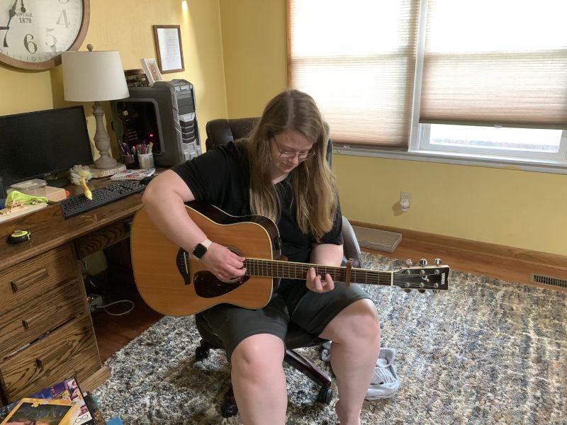 Meghan Playing Guitar